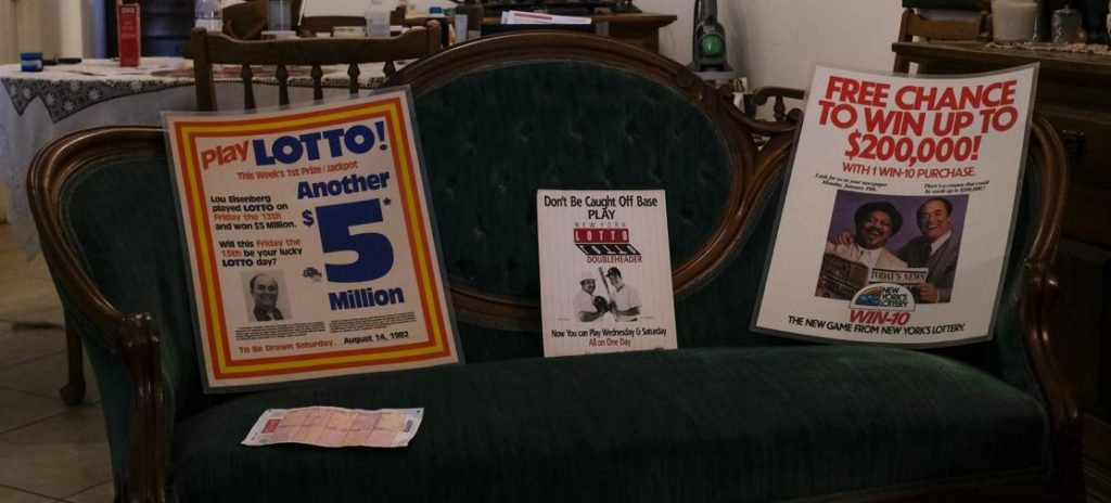 Победитель Лу Айзенберг рекламирует лотерею Нью-Йорка